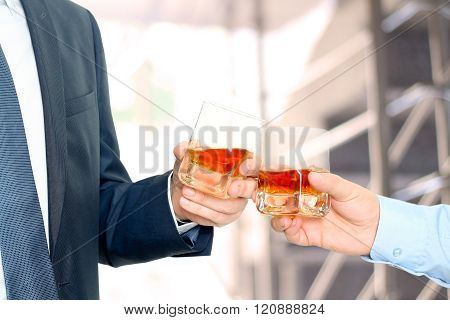Holiday Event Business People Cheering Each Other With Whiskey
