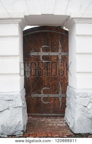 close up old wooden door with metal loops
