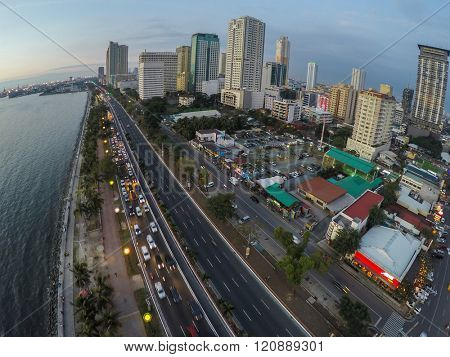 Manila, Philippines - January 19, 2015: Roxas Boulevard, Manila at evening, high-rise buildings skyscrapers with night lights.