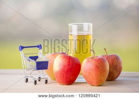 apple juice a shopping cart on a wooden table, outdoor