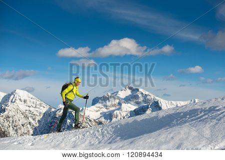 Man Snowshoeing In Mountain
