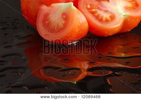 Tomato reflection on watery surface