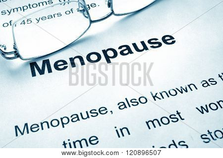 Menopause written on a paper.
