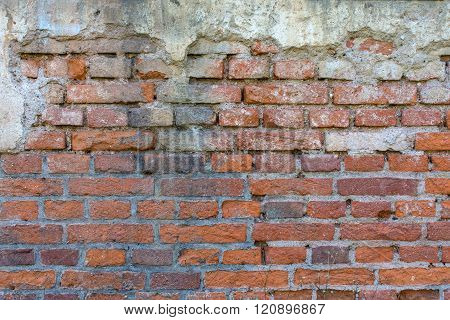 Reddish Brown Brick Wall With Plaster