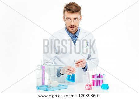 Scientist doing experiments with rat in a laboratory