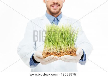 Cropped imaage of a male engineer showing a modified plants isolated on a white background