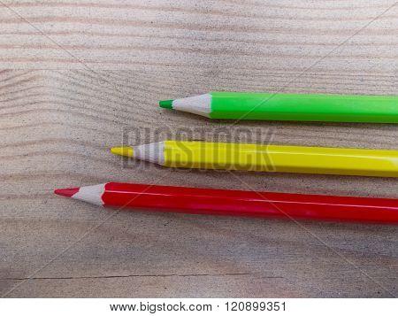 Three colored pencils