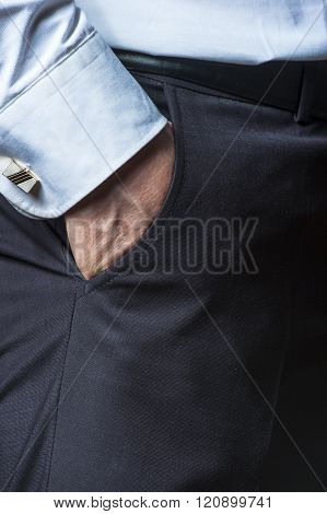 Man's hand in the suit's pocket closeup.