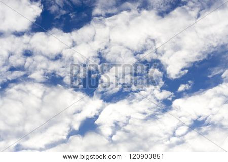 cirrus clouds against the blue sky background