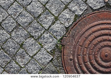 Old Pavement Block And Manhole