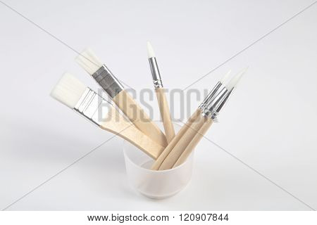 White Paintbrushes With Wooden Handle In Jar