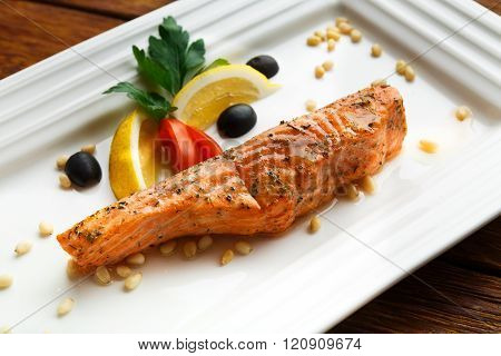 Restaurant food - grilled salmon with lemon.