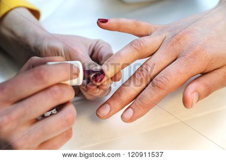 Manicurist Is Applying Nail Varnish.