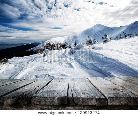 Wooden table and winter background
