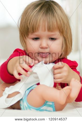 Little Girl Playing With Her Baby Doll