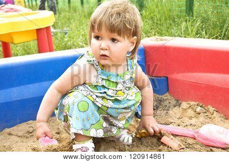 Little Girl In The Sandbox