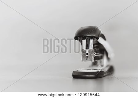 Stapler On A Wooden Background