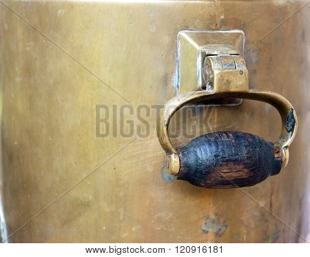 handle of old russian bronze samovar. Retro russian background