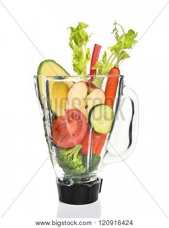 Vegetables in a blender ready for juicing. Healthy eating concept.