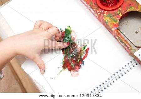 Hand Of Little Child Draws A Finger Paints