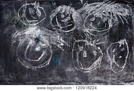 Children's Drawing White Chalk On Old Blackboard