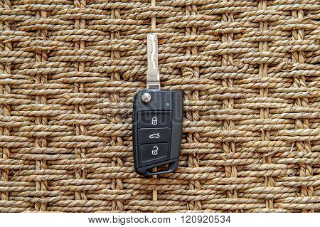 New car key in branded gift box against natural bacground