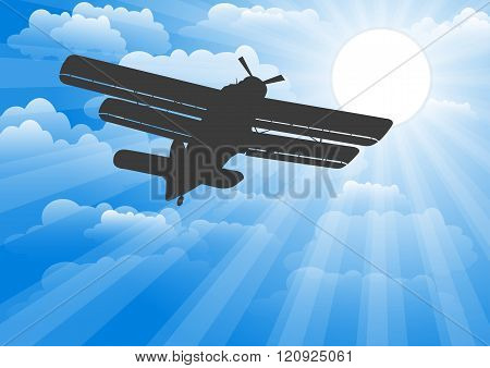Biplane on the background of the sunny sky. Vector.