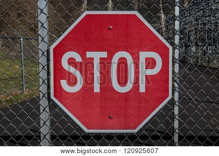 Stop Sign On Chainlink Gate