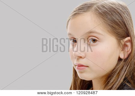 portrait of preteen girl isolated on  grey background