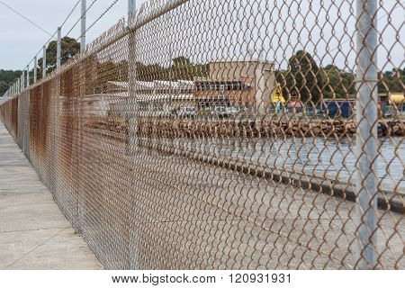 Old Rusty Metalic Mesh Cage Fence