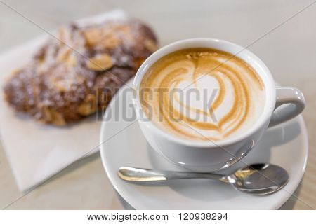 Italian cappuccino with fresh almond cornetti. Low depth of field