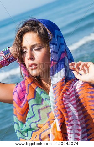 tanned young beach fashion woman portrait with  colorful sarong enjoy in sun  at sea beach summer day