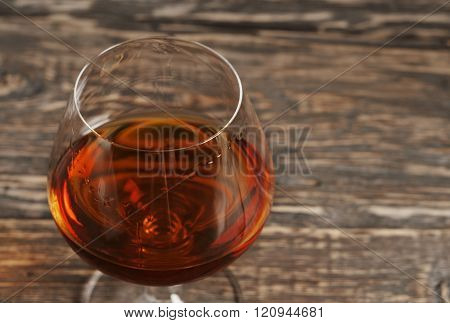 Cognac, brandy or whiskey in large round glass