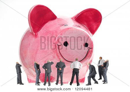 Business men looking at a large piggy bank studio isolated on white background
