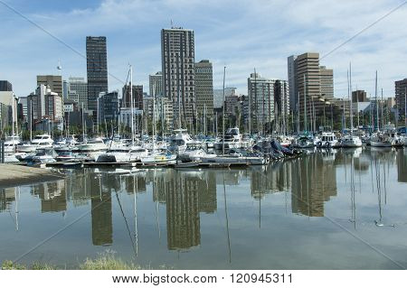 Reflections Of Yachts And Buildings In Still Water, Durban
