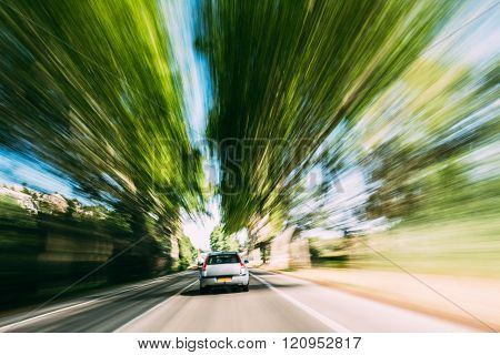 Speeding Car On A Highway, Country Asphalt Road. Motion Blur Bac
