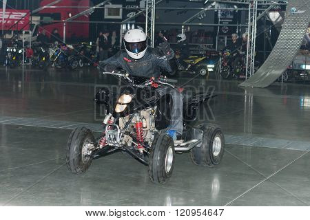 Stuntman Riding A Quad Bike Atv During Stunt Show
