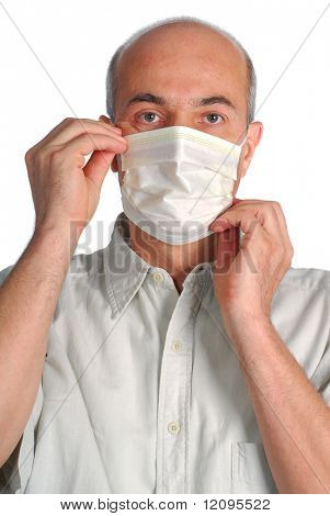 A man is wearing a mask on his face to protect himself from any viruses