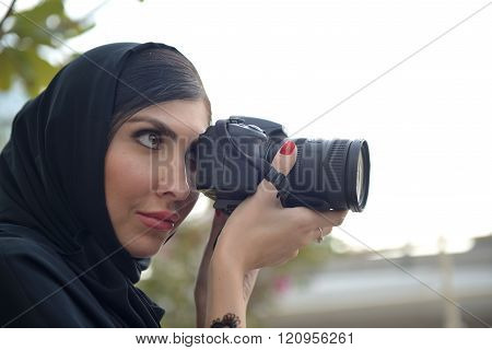 Emarati Arab  Woman Taking Photograph In Dubai