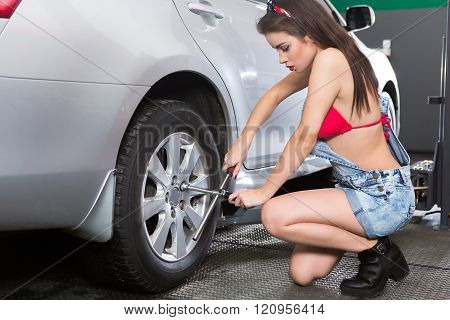 Tire servicing woman