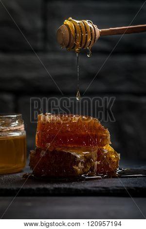 Honey Dripping From A Wooden Honey Dipper
