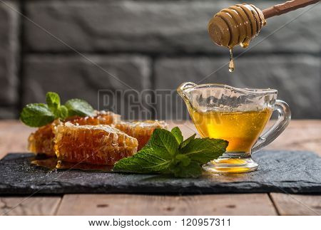 Honey Dripping From A Wooden Honey Dipper