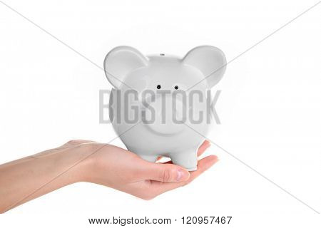 Hand holding piggy bank, isolated on white