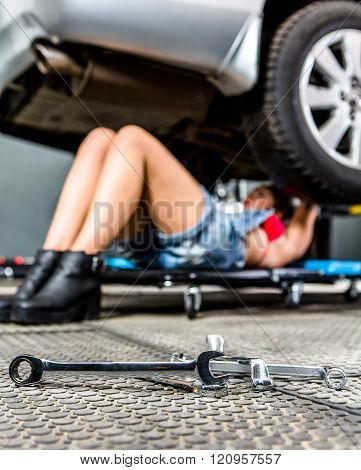 Car mechanic woman