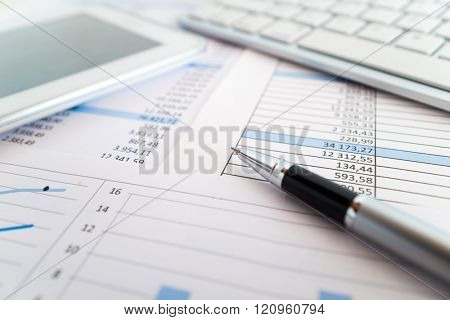 Detail of paperwork and business related objects in an office