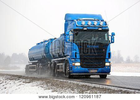 Blue Scania Tank Truck Trucking In Snowfall