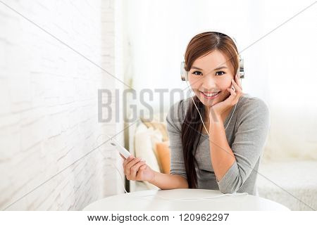 Woman listening to song with music player