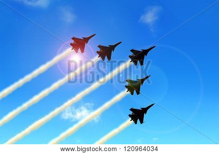 Military Aerobatic Jets Formation Under Blue Sky During Air Show