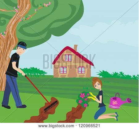 Couple With Garden Tools Working Together At Garden