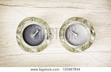 Two Candlesticks Of Glass With Tea Lights